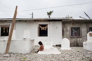 A child plays in a cemetery on Majuro, the capital of the Marshall Islands. With the increase of flooding, some cemeteries on the island are being washed out to sea.