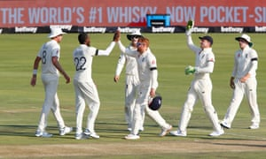 England's Jofra Archer is congratulated by his teammates after taking the wicket of South Africa's Keshav Maharaj.