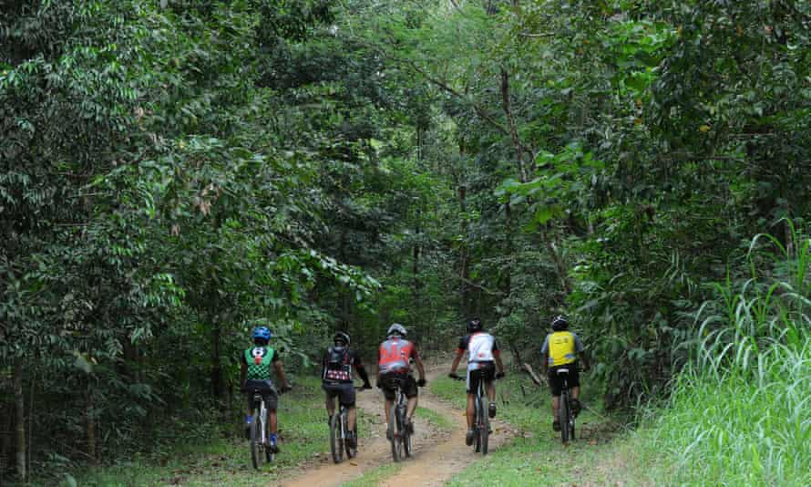 Pedalling through paradise: mountain bikers stick to the city to explore trails through Manila's regenerated La Mesa watershed.
