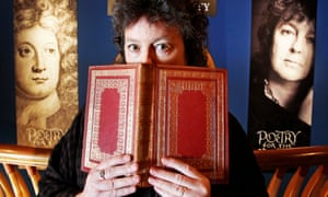 'Alert at the lip / of wordlessness' … Carol Ann Duffy with a volume of Tennyson in front of a portrait of the first poet laureate, John Dryden.
