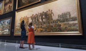 Visitors at the Imperial War Museum North look at Gassed by John Singer Sargent.
