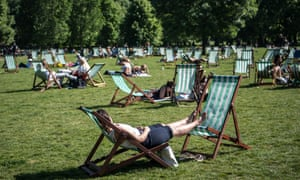 Woman relaxes on deckchair in London.