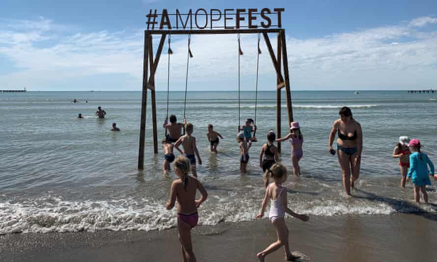 Children play in the water at a public beach in Anapa.