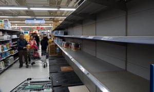 Customers looking for toilet paper find empty shelves, at a supermarket in Taipei