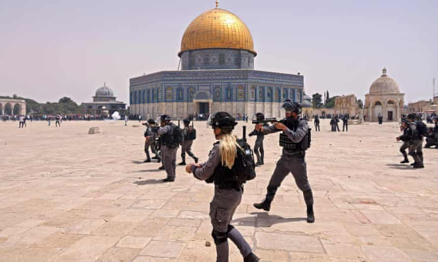 Israeli security forces and Palestinian Muslim worshippers clash outside Jerusalem's al-Aqsa mosque on 21 May.
