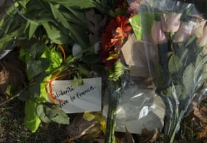 Items are left outside the French embassy in Washington DC the day after Paris attacks