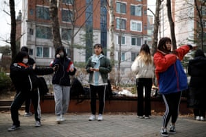 Nao Niitsu, a college freshman from Tokyo, who wants to be a K-pop star, and other Japanese children warm up for an audition at a park in Seoul
