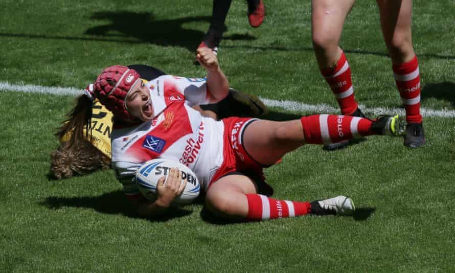 St Helens' Emily Rudge celebrates scoring her try