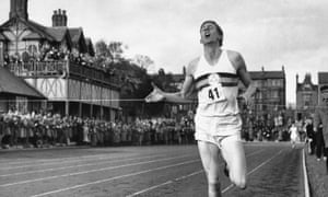 Bannister breaks the tape to become the first man ever to break the four-minute barrier in the mile at Iffly Field in Oxford.