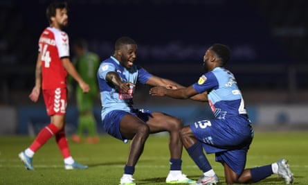 Wycombe's delighted players celebrate at full-time.