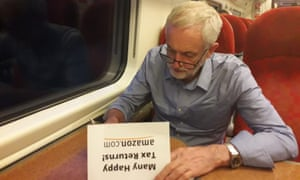 Jeremy Corbyn signing his 'happy tax returns' card to Amazon in an image posted on his Twitter account.