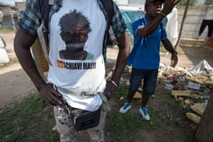 A resident wearing a t shirt comemerating Sacko Soumalya who was shot in the head collecting waste metal.