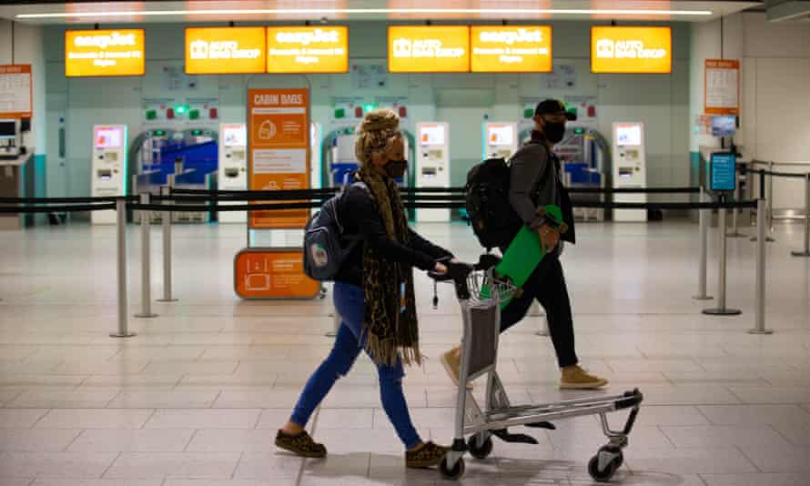 Passengers at Gatwick airport as easyJet relaunches flights from the UK to green-lit destinations.