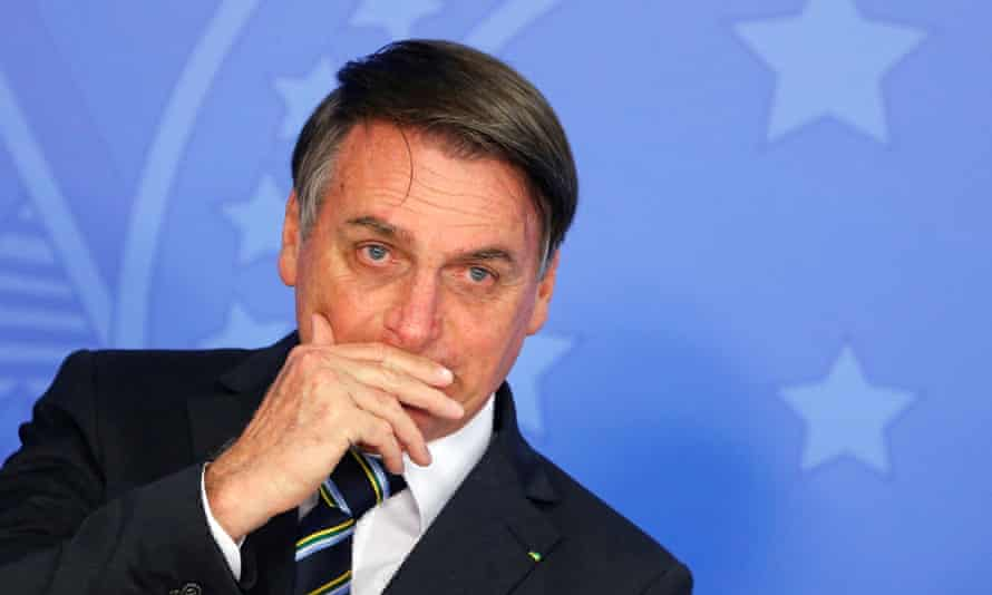 Jair Bolsonaro gestures during a ceremony at the Planalto Palace in Brasilia, Brazil.