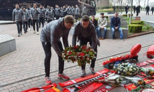 Jürgen Klopp and Jordan Henderson lay a wreath at the Hillsborough disaster memorial outside Anfield in 2019.