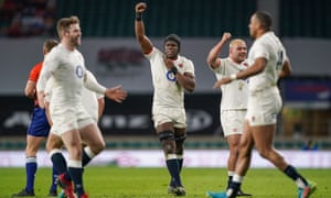Maro Itoje of England celebrates at full-time alongside Ellis Genge.