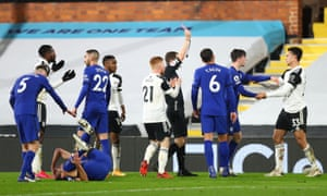 Fulham's Antonee Robinson is shown a red card by referee Peter Bankes.