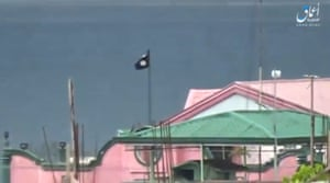 Marawi, Philippines  a black flag flying on a building in Marawi City