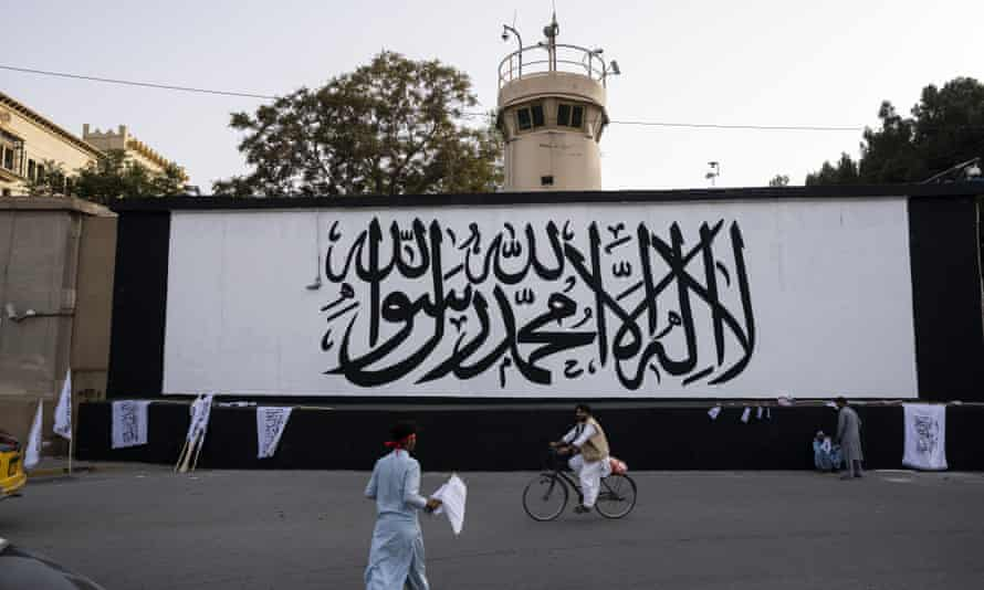 The Taliban flag painted on a wall outside the American embassy compound in Kabul, Afghanistan, on Saturday. (AP Photo/Bernat Armangue)