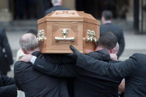 Pallbearers carry her coffin into the cathedral