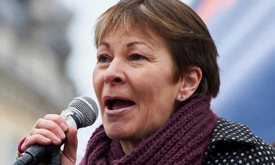 Caroline Lucas with microphone in hand addresses an outdoor rally