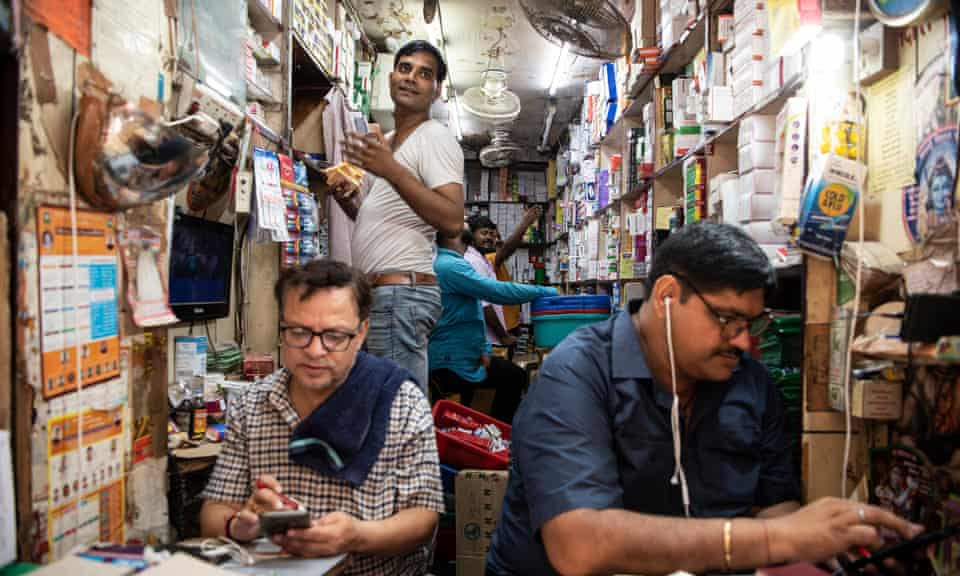 Workers at a pharmacy shop at Bhagirath Palace's pharmaceuticals market in Old Delhi, India.