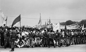 Indonesian troops control a crowd of students following the abortive Communist coup of 1965.