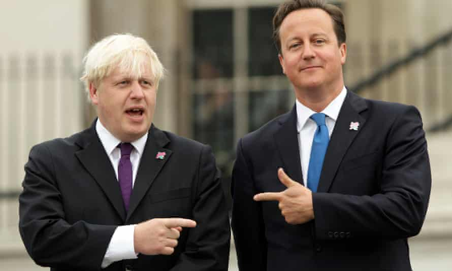 Old Etonians Boris Johnson and David Cameron, smiling and pointing at each other