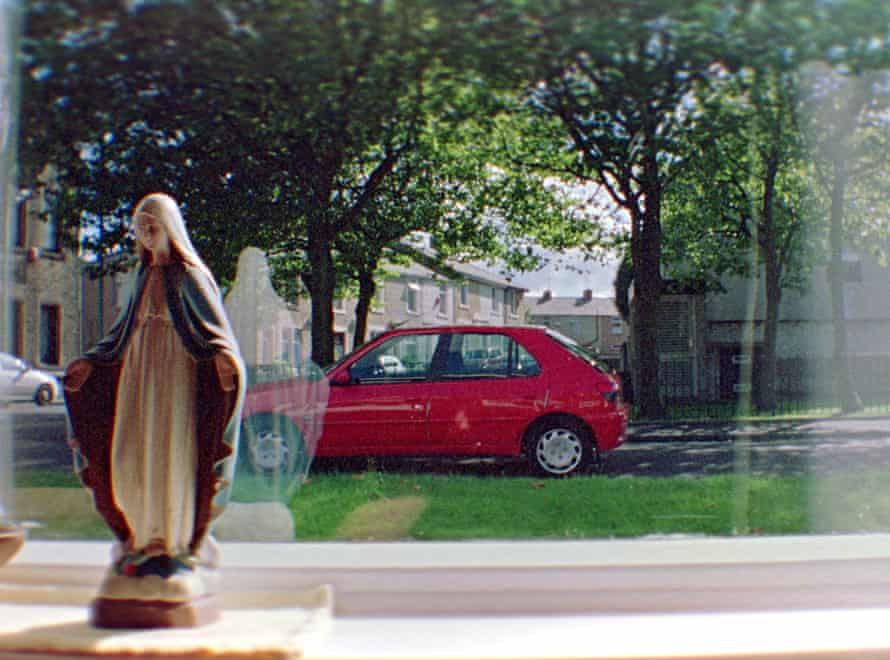 Statue of the Virgin Mary in the window.
