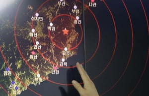 An official of the South Korean earthquake and volcano monitoring agency points at the epicentre of seismic waves in North Korea on Friday.