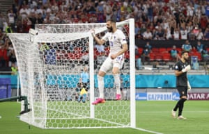France's Karim Benzema celebrates scoring their first goal.