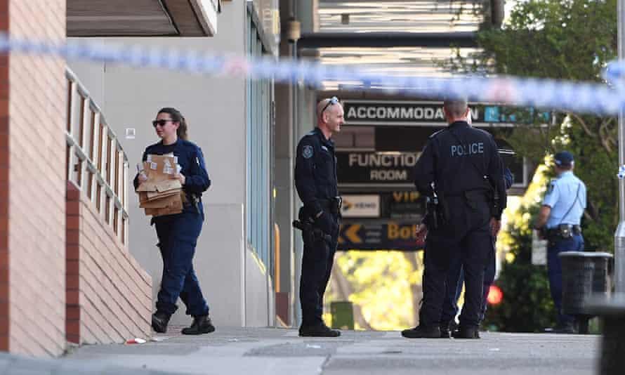 Police examine the crime scene outside Penrith police station