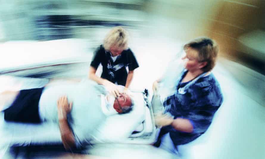 Hospital trauma staff with patient.
