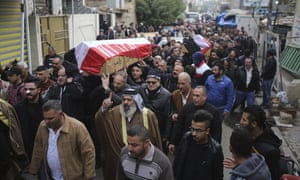 Mourners carry the coffins of bomb victims Arif Muhanad, 36, and his son Muhanad, 8.