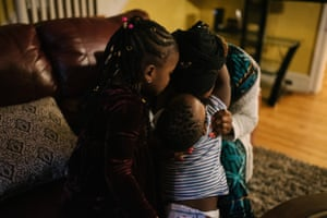 Fatu Kante sits with her son, Aly, 2, and daughter Sera, 4, at their home in Philadelphia, PA. on Monday, February 25, 2020. Both Sera and Aly were found to have lead poisoning due to the old paint in their current home.