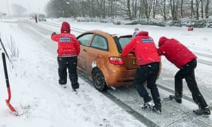Search and rescue team push car