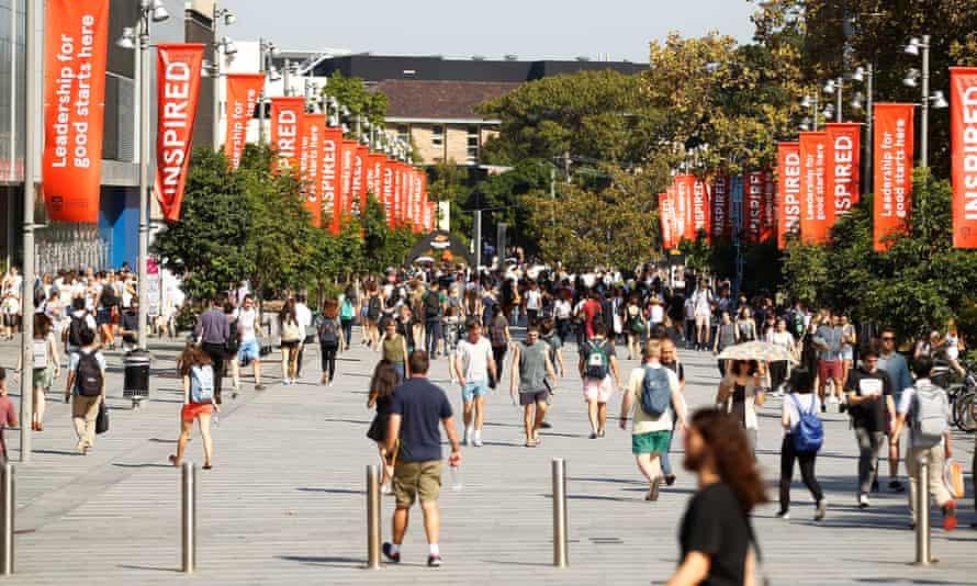 Students walk around Sydney University's campus