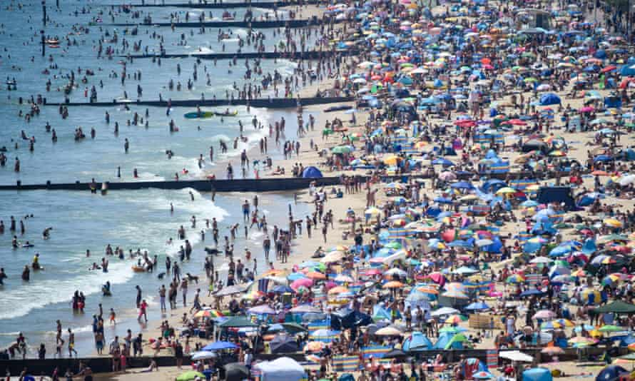 Visitors crowd Bournemouth beach on 25 June.