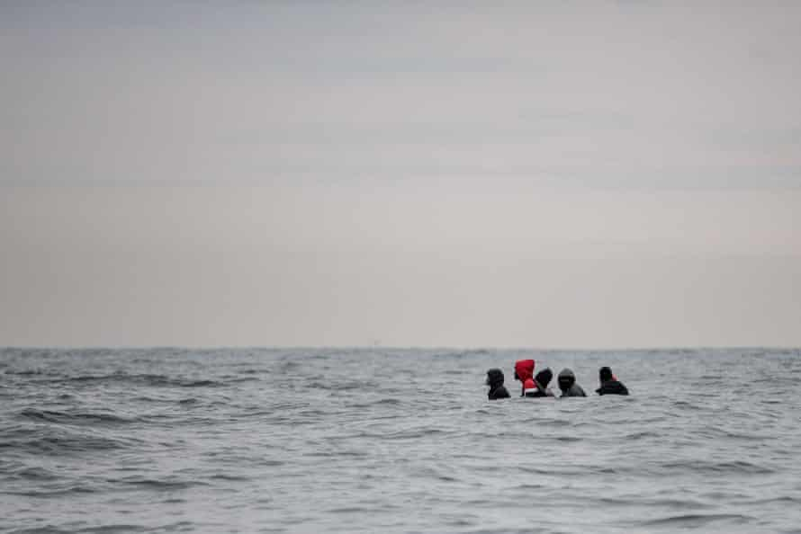 Migrants in a small boat off Sangatte, France, as they try to cross the Channel.