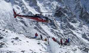 A rescue helicopter at Mount Everest south base camp. The small aircraft could only take two or three climbers on each flight.