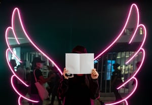 A protesters holds up blank paper as she takes part in a rally in a shopping mall on 21 July in Hong Kong