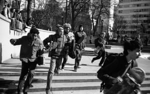 Skateboarders run from police during a raid. Skateboarding was made illegal in the park in the mid 1990s.