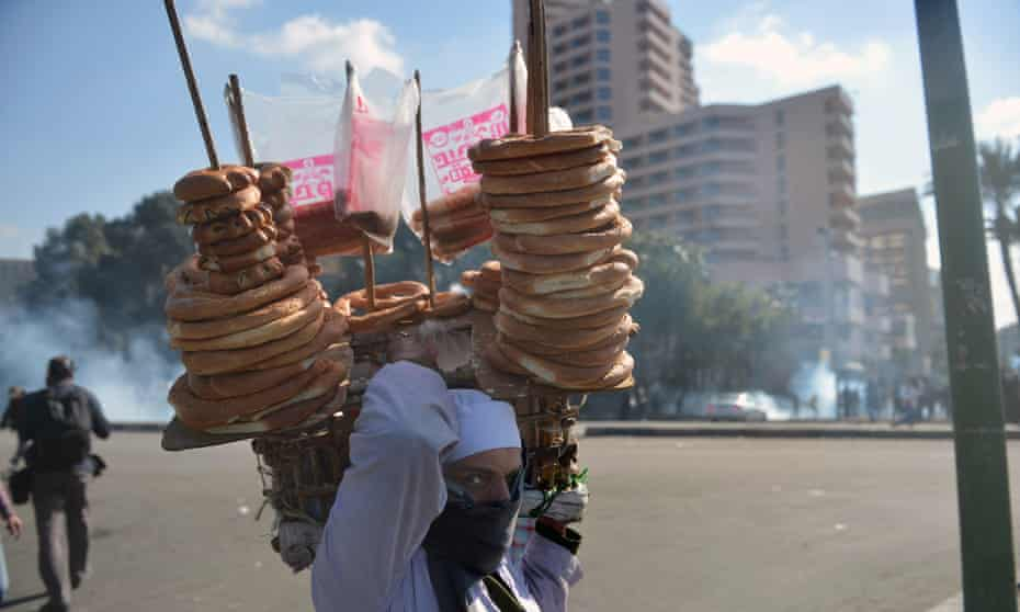 A street vendor near Tahrir Square, in 2013. In recent years, the Egyptian police have recruited some of them as informants.