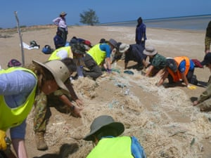 Tangaroa Blue volunteers retrieving ghost nets at a beach in Mapoon, Queensland