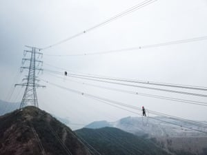 Zhoushan, China, Technicians from the State Grid Zhejiang Electric Power Company check power transmission lines to ensure the stable operation of local power supply