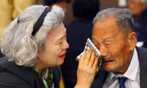 South Korean Lee Jung-sook wipes the tears from her North Korean father Lee Heung-jong at the end of their reunion in 2015