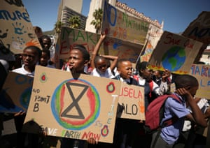 South African students brandish protest signs in Cape Town