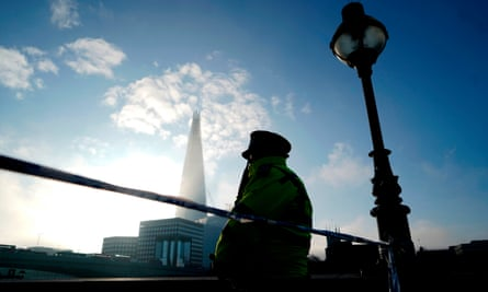 A police officer stands guard at a cordon near London Bridge on 30 November 2019.
