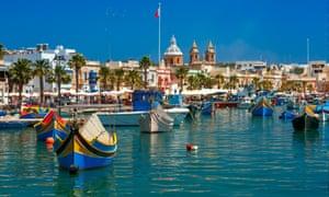 Traditional eyed boats Luzzu in Marsaxlokk, Malta