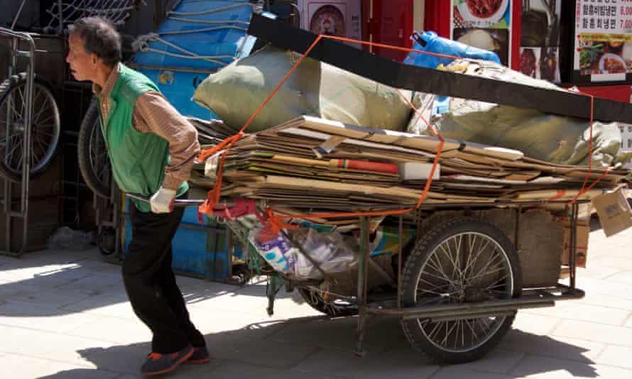 A cardboard collector near Tapgol Park in Seoul.